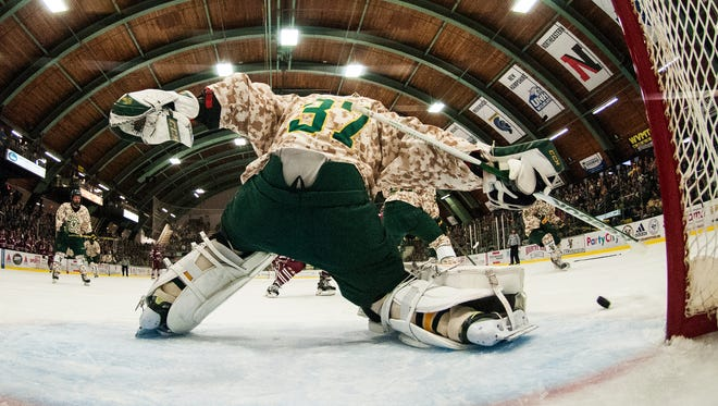 Vermont goalie Brody Hoffman (37) makes a save during the men's hockey game against UMass at Gutterson Fieldhouse last month.
