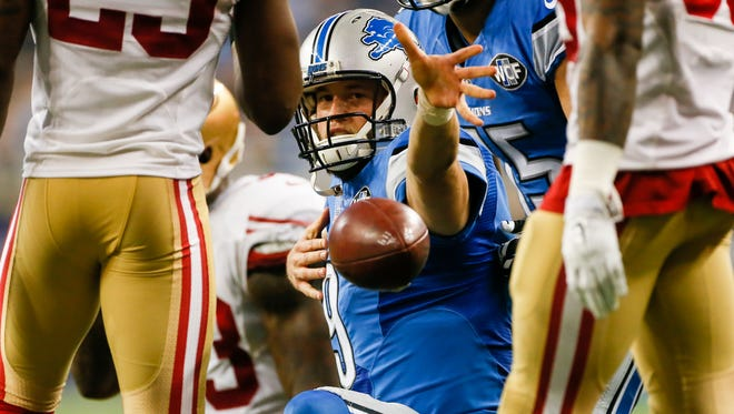 Detroit Lions QB Matthew Stafford holds the ball out after running for a first down against the San Francisco 49ers during the fourth quarter of the NFL game at Ford Field in Detroit on Sunday, Dec. 27, 2015.