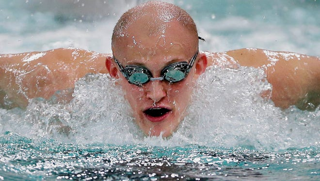 Wauwatosa West senior Danny Larson practices his freestyle and other types of swimming during practice Jan. 25 at Wauwatosa West High School.