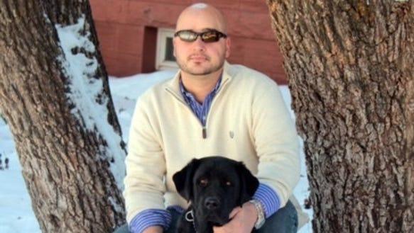 Brian Mancini with his service dog Romeo.