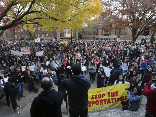 A large crowd gathers during a protest over some of President elect Donald Trump policies and to ask school officials to denounce some of his plans at Rutgers University Wednesday, Nov. 16, 2016, in New Brunswick, N.J. College students at campuses around the United States say they are planning rallies and walkouts to call on school administrators to protect students and employees against immigration proceedings under Donald Trump's presidency. (AP Photo/Mel Evans)