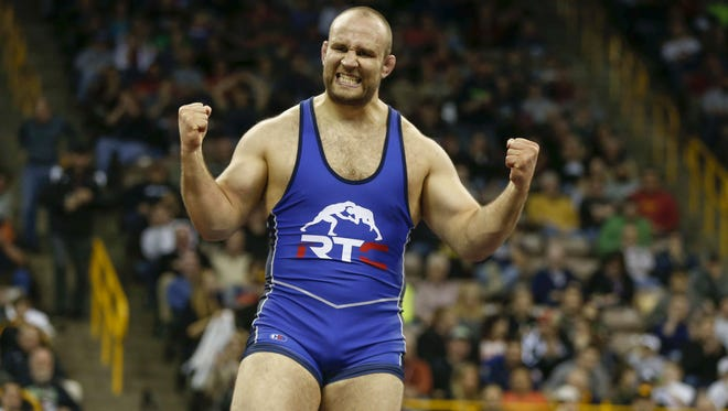 Tervel Dlagnev celebrates an Olympics-qualifying win over Zach Rey in their match on Saturday, April 9, 2016, during the wrestling Olympic Trials at Carver-Hawkeye Arena in Iowa City, Iowa.