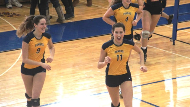 Hannah Talkers (9), Abby Thelen (11) and Morgan Hentz (4) celebrate after Thelen's kill gave the Pandas the first set win.