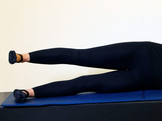 Erin Stern shows the ending position for the Pilates exercise, side leg series.