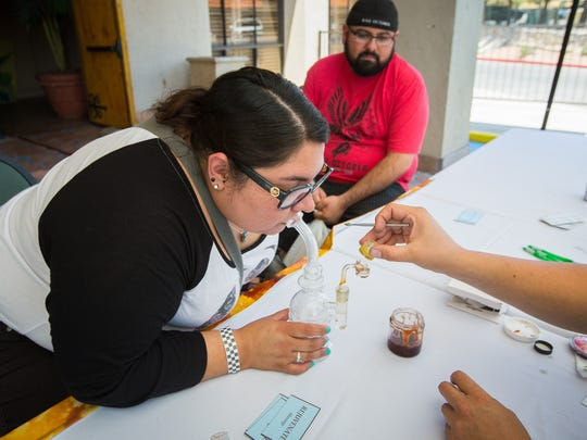 Priscilla Duran tries the cannabis compound Cannabidiol from the CBD Boutique during the Southern New Mexico Medical Cannabis Expo at the Hotel Encanto de Las Cruces, June 24, 2016. Duran says she finds the compound helpful for her PTSD and anxiety.