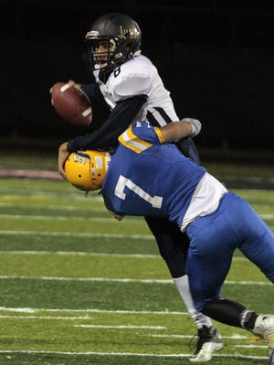 Luke Kues of NewCath picks up another sack late in the game.  Newport Central Catholic met Lloyd Memorial at Newport Stadium in the Kentucky regional tournament Friday night, November 20th, 2015.