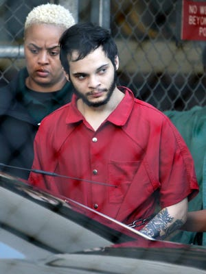 Esteban Santiago is led from the Broward County, Fla., jail for an arraignment in federal court Monday, Jan. 30, 2017, in Fort Lauderdale. Santiago is charged in a 22-count federal indictment in the Jan. 6, 2017, fatal shooting at the Fort Lauderdale-Hollywood International Airport.