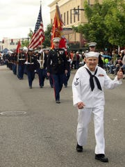 Burke Waldron gives a thumbs up to the crowd as he takes part in the annual  Armed Forces Day Parade in Bremerton, Wash. on Saturday, May 17, 2014.