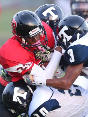 Dearborn Heights Robichaud's Jalen Wilson runs the ball against Redford Thurston on Sept. 18, 2015.