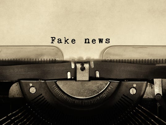 Fake news words typed on vintage typewriter.