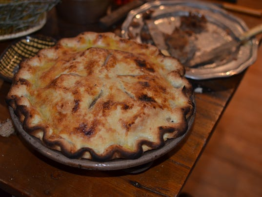 Freshly-baked apple pie cooked over open hearth
