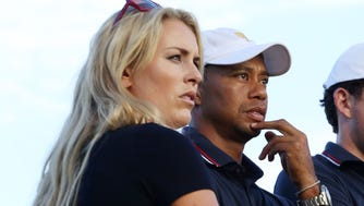 Oct 3, 2013; Dublin, OH, USA;  USA skier Lindsey Vonn, Tiger Woods, and Keegan Bradley watch from the 17th green during the Presidents Cup at Muirfield Village Golf Club. Mandatory Credit: Brian Spurlock-USA TODAY Sports