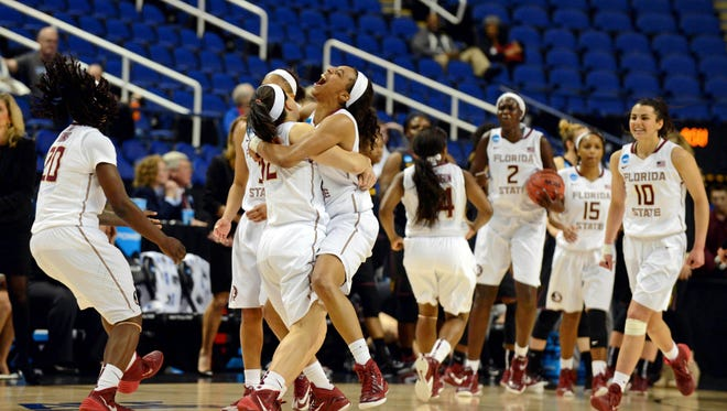 Florida State Seminoles players celebrate after defeating the Arizona State Sun Devils in the semifinals of the Greensboro regional in the women's 2015 NCAA Tournament at Greenboro Coliseum Complex. The Seminoles won 66-65.