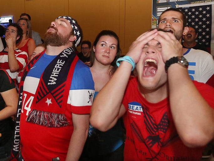 "Tim Kenyon reacts to a near miss on Sunday. Rabid soccer fans watched U.S.A vs. Portugal match at the Parlay Sports Bar and Grill on Sunday June 22, 2014.  Some wore American flags, Red, White and Blue regalia and ""Beat Portugal"" signs.  The American Outlaws (Tallahassee's main soccer fan group) were in attendance at Parlay. The USA team tied the score late in the second half, eventually took a lead only to see Portugal tie it with just seconds to go in the match at 2-2."