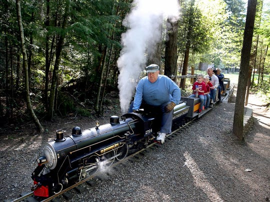 Kitsap Live Steamers locomotive engineer Nick Buell gives rides at the South Kitsap Community Park.