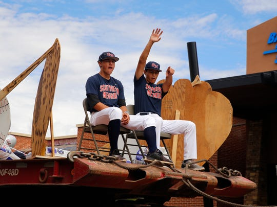 Players from the Southern Nevada team wave Friday during the Connie Mack World Series Parade in Farmington.