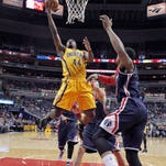 Indiana Pacers forward Solomon Hill (44) shoots in front of Washington Wizards guard Bradley Beal, right, during the first half of an NBA basketball game Wednesday, March 25, 2015, in Washington. (AP Photo/Alex Brandon)