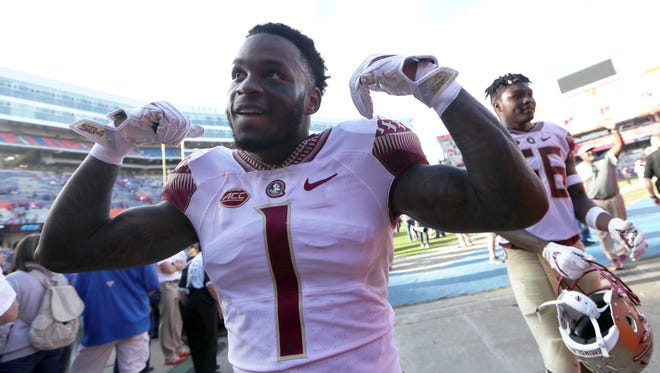 FSU'sLevonta Taylor celebrates after the Seminoles 38-22 win over Florida at Ben Hill Griffin Stadium in Gainesville on Saturday.
