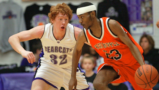 Muncie Central's John Peckinpaugh defends against Broad Ripple's Steve Shepherd during their game Tuesday night at the Fieldhouse.  Chris Bergin/ The Star Press
