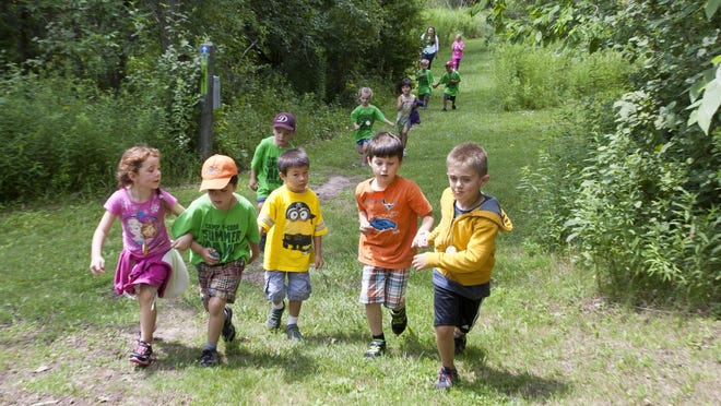 Children sprint up a hill at the Ellwood H. May Environmental Park during a day camp at the park on Wednesday July 22 in Sheboygan. Staff from Camp Y-Koda is working with Maywood to develop the summer programs.