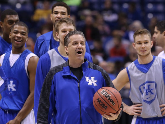 UK head coach John Calipari and and his players laugh as they watch a teammate miss a half court shot during practice ahead of their Sweet 16 match up with U of L at the Lucas Oil Stadium in Indianapolis. Mar. 27, 2014