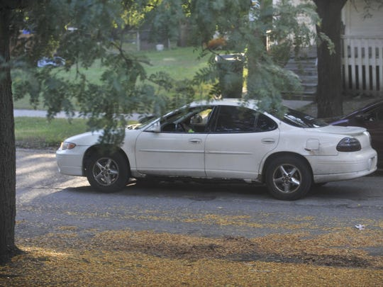 A Pontiac pulls away from an undercover officer; the Ferndale driver was stopped and the car impounded. Officers say in neighborhoods that border the suburbs, almost all drug buyers are from outside Detroit.