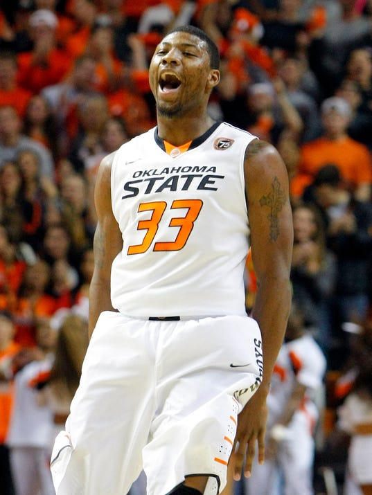 Oklahoma State Cowboys guard Marcus Smart celebrates after shooting a