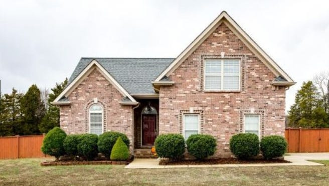 This three-bedroom, two-full-bath home is in the Gladeville community. Features include a Bosch dishwasher, a spa tub in the master bath and a water softener. The house has attic storage and a fireplace.