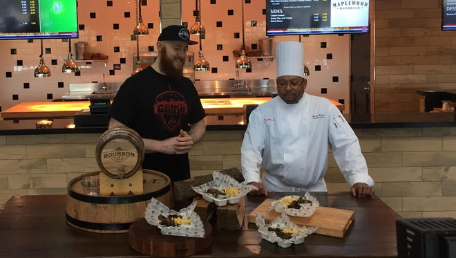 "Aron Baynes and Palace executive chef Lamar Nolden show off their new ""House O' Bayne"" plate."