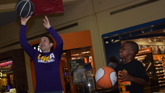 LSUA men's basketball head coach Larry Cordaro (left) and Gage Grant shoot hoops at the Alexandria Mall Saturday. The LSUA Generals were at the mall signing autographs and meeting fans.