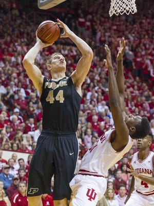 Purdue center Isaac Haas puts up a shot as he's defended by Indiana's Thomas Bryant (31) during the first half at Assembly Hall in Bloomington.