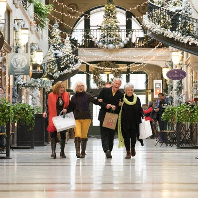 Shoppers enjoy the Winter Wonderland at the Grove Arcade.