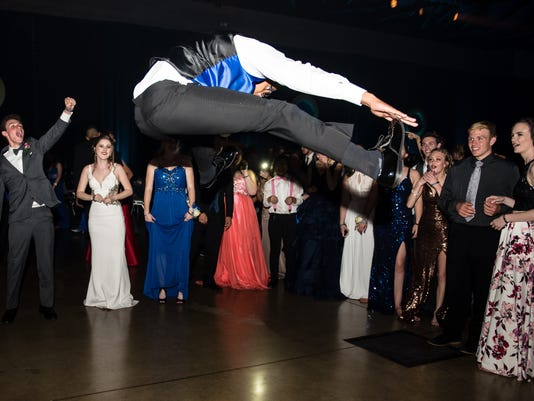Redwood High School's, Jeremiah Almond, shows his moves during the Visalia Prom on May 13, 2017