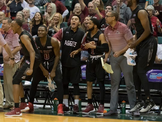 The New Mexico State bench cheers late in the second