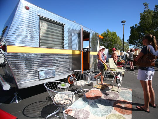 A 1961 Holiday House trailer is displayed and open