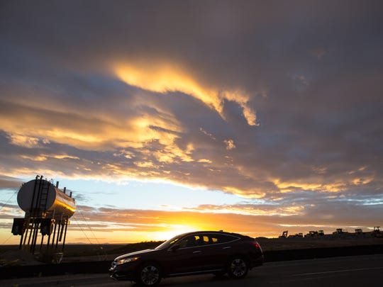 Las Cruces skies are cloudy on Monday, Nov. 28, 2016, during sunset as winter weather moves into the area. Winds are expected to continue through Tuesday, while Tuesday night's low is expected to dip to 25 degrees.