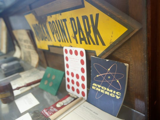 An old sign and a pamphlet on atomic energy at the