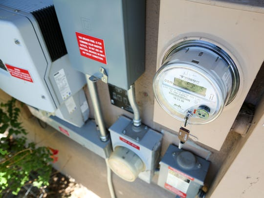 """Many meters are pictured on the side of the Westbrook home on Sunday, August 6, 2017. The home is a """"net-positive energy"""" home, generating more power than it consumes."""