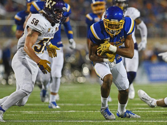 SDSU's Adam Anderson (80) carries the ball during a
