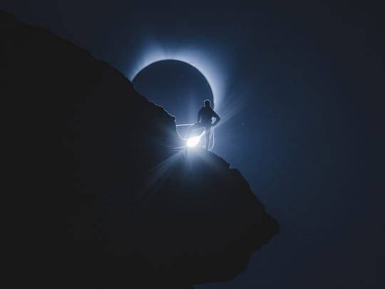 This photo by Andrew Studer of Salem, which shows a rock climber in front of eclipse totality at Smith Rock State Park, has been widely shared across the Internet.