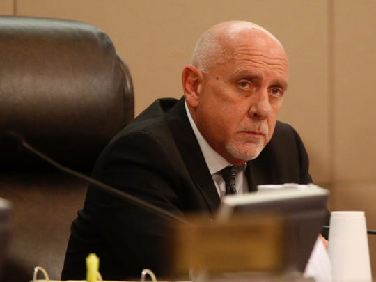 Former City Manager Rick Fernandez listens to Erwin Jackson's criticisms during the Oct 25 City Commission Meeting held at City Hall.
