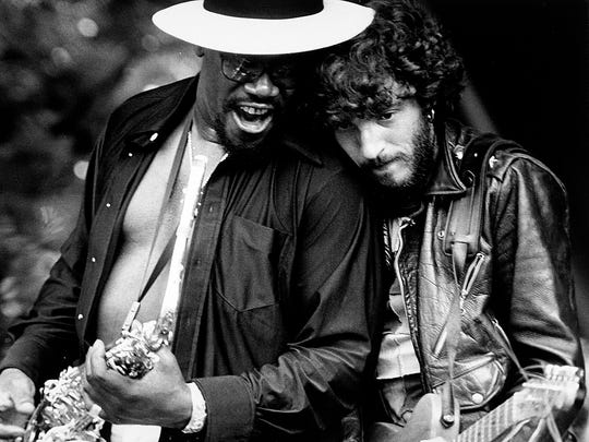 "Bruce Springsteen and Clarence Clemons perform on stage during the third stop of the ""Born to Run"" tour at Music Inn in Lenox, MA on July 23, 1975."