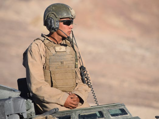 The driver of an amphibious assault vehicle waits for