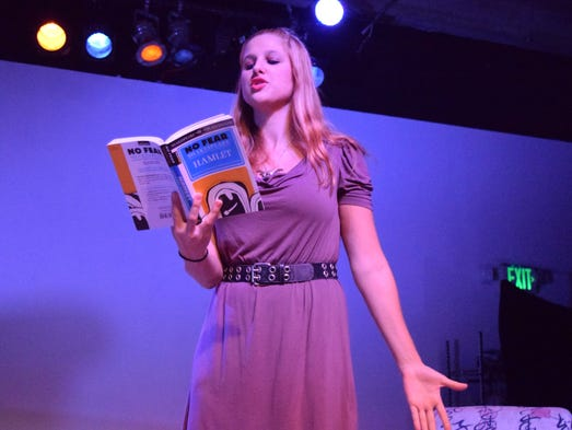 """Chloe McElroy reads from a book during a scene of """"Women"""