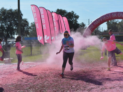 A runner runs through pink-colored corn starch during