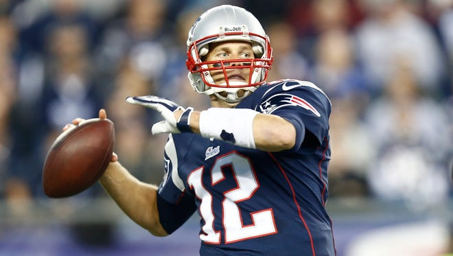 New England Patriots quarterback Tom Brady (12) passes the ball against the New Orleans Saints during the second half at Gillette Stadium in Foxborough, Mass. on Oct. 13, 2013.