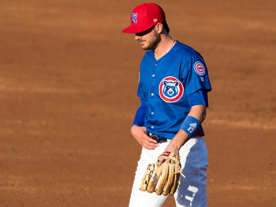 Third baseman Kris Bryant between innings Monday.