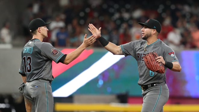 Jul 13, 2018; Atlanta, GA, USA; Arizona Diamondbacks shortstop Nick Ahmed (13) and left fielder David Peralta (6) celebrate their win in the ninth inning against the Atlanta Braves at SunTrust Park. Mandatory Credit: Jason Getz-USA TODAY Sports