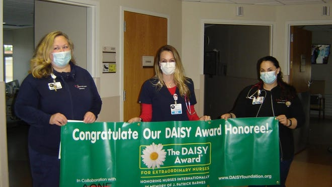 Teri Dagnasi receives the DAISY Award for extraordinary nurses at Geneva General Hospital. Pictured, from left, are Melissa Grummons, 2 West nurse manager, with Dagnasi and Leann Alfonso.