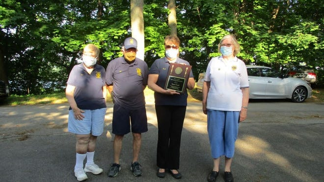 Irondequoit Lions President Sue Kunath receives her Uplinger Award. Pictured, from left, are Bev Bloss, Bill Davis, Kunath and Judy MacKnight.